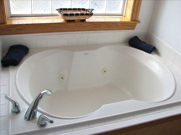 Relax in the Top Floor Master Bedroom Jacuzzi