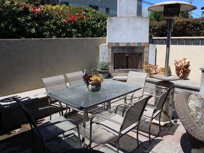 Patio dining table with fireplace in background
