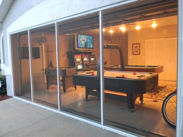 The Game room is screened-in for cool playing comfort.