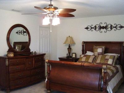 Port Charlotte house rental - Master bedroom with adjoining master bath with direct pool access