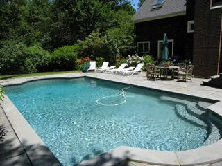 Jamestown (Conanicut Island) house photo - A heated pool is surrounded by a gracious blue stone patio.