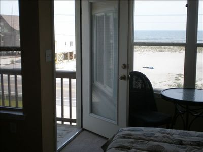 Door to deck in 2nd master bedroom with view of gulf and beach