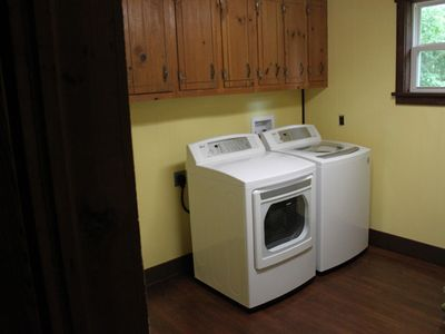 Full sized laundry room complete w/laundry soap and dryer sheets
