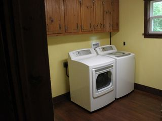 Winston-Salem farmhouse photo - Full sized laundry room complete w/laundry soap and dryer sheets