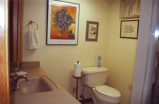 Interlochen studio photo - Well-appointed bathroom with tiled floor and more art.