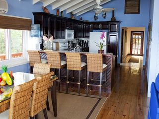 Roatan house photo - View of dining area and breakfast bar looking into the kitchen