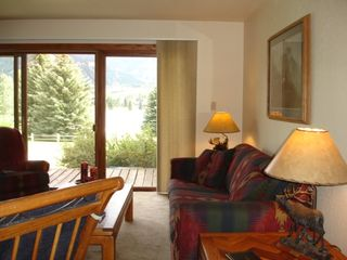 Avon condo photo - living area - view of lake, park, & Beaver Creek