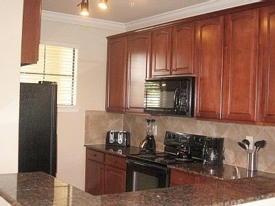 Gleaming granite counter tops, solid wood cabinetry, raised eating bar...