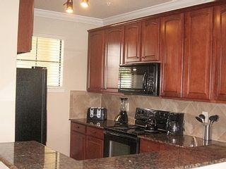Gleaming granite counter tops, solid wood cabinetry, raised eating bar... - Bella Piazza condo vacation rental photo