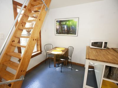 Cute little dining area under the stairs. Fabulous photos of live music events.
