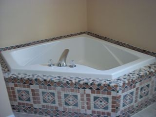 Avalon house photo - Large soaker tub on second floor. This bathroom also includes a shower.
