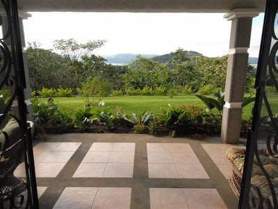 This is your view, through the open doors of your living room to Lake Arenal!