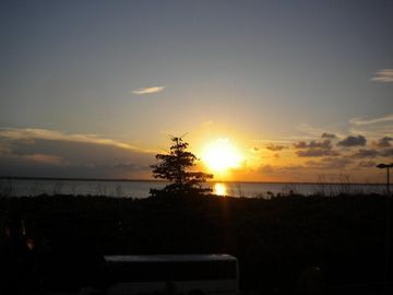 View of the sunset from your Bellevue/Hotetur Beach Paradise balcony!.