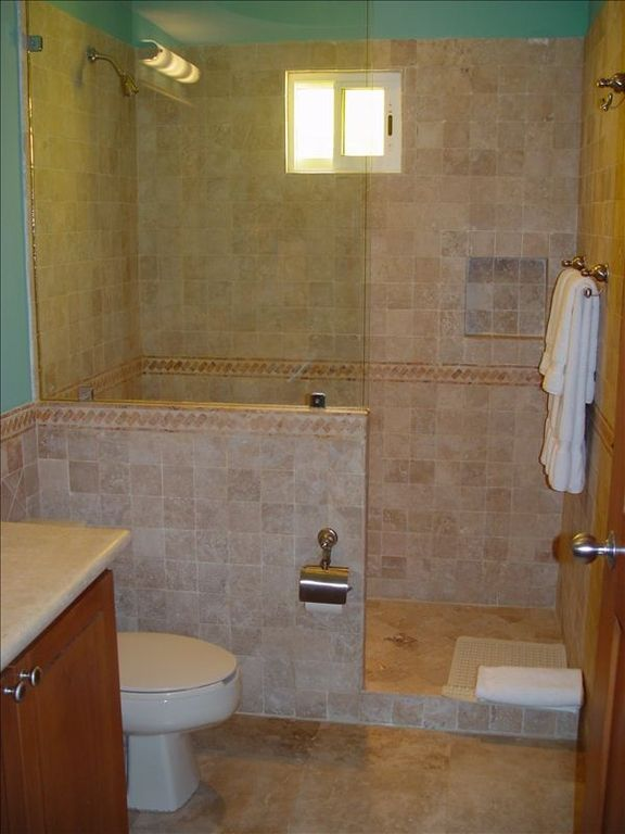 Third bathrrom w/ single sink and stone walk-in shower