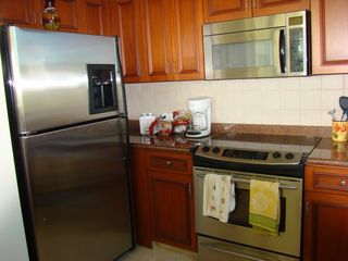 Humacao condo photo - Kitchen WIth Stainless Appliances Granite Countertop