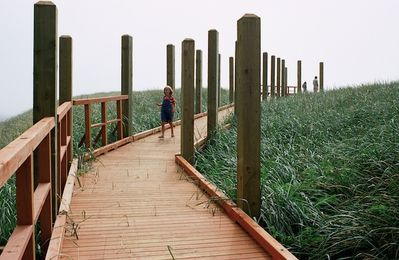 Private beach access via a unique wooden boardwalk