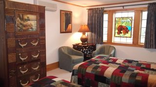 Lake Placid property rental photo - Bedroom with 2 queen beds and own bathroom with shower