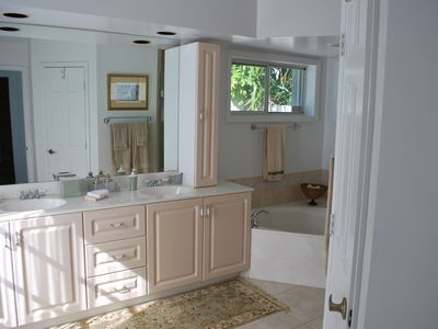 Downstairs Master Suite Bathroom w/ Double Sinks, Toilet Closet & Walk in Shower