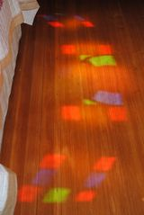 Newport house photo - Stained glass light reflects off the freshly restored antique hardwood floors.
