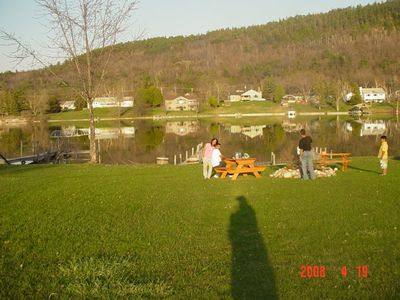 Lakefront with boat dock and recreational area
