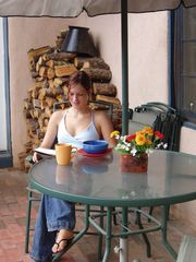 Taos house photo - Enjoy the patio in summer (granddaughter not inc.)