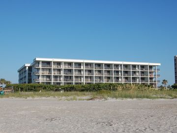 Picture of resort taken from the beach. Resort has basketball and tennis courts.