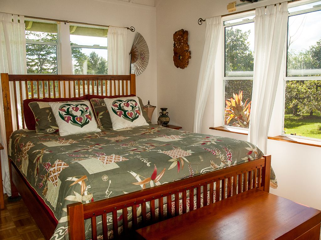 Open and airy bedroom with valley views and a comfortable queen bed