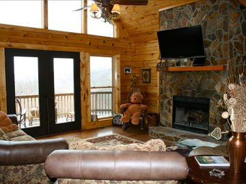 Great room with a wood burning fireplace and nice views.