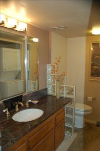 Master Bathroom with granite counter top & glass block wall. Washer & Dryer.