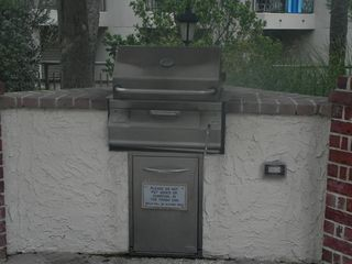 Palmetto Dunes condo photo - One of the four bar-be-que grills in the picnic area.