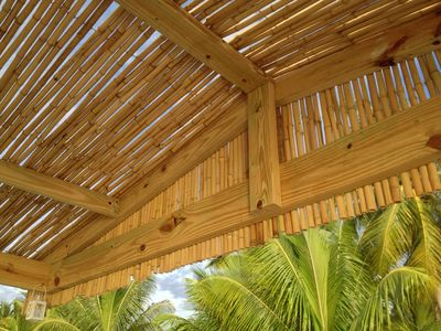 The bamboo roof covered upper deck dining area