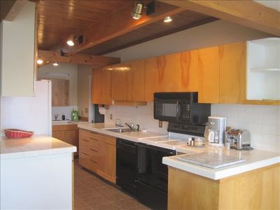 Full Kitchen with All the Amenities and Lots of Room to Dine with a View