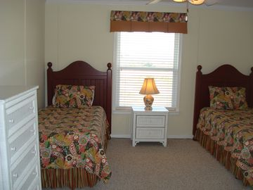 Twin beds w/new Serta matresses, TV w/DVD player, large chest of drawers.