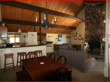 Big Bear Lake townhome rental - spacious living area with wood burning gas fireplace
