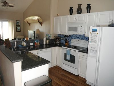 Our beautifully remodeled Kitchen has all new applicances & granite countertops