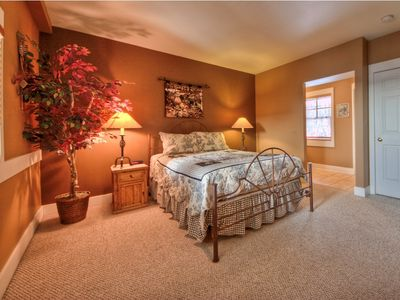 Large master suite with queen bed and private bath