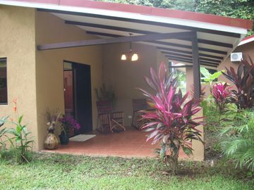 Los Suenos Resort bungalow rental - Side view of our front patio. Spacious garden, hang a hammock and enjoy!