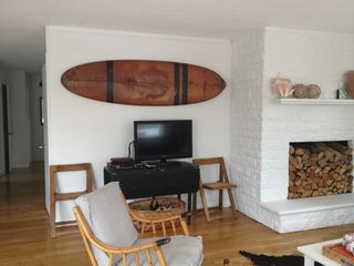 Bonnet Shores house photo - vintage surfboard! hallway leads to 3 bedrooms.