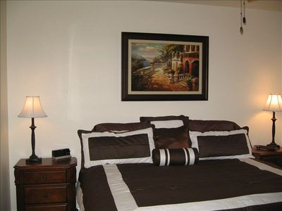 King Bed in Master Bedroom with spacious Master Bath and flat screen TV.