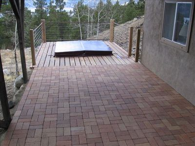 Lower patio leading to hot tub