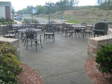 Patio area at clubhouse, perfect for grilling out and relaxing by the pool!