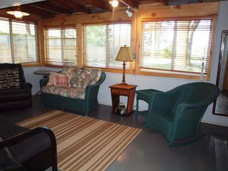 Montague cabin photo - Enclosed porch with flat screen tv, futon and lots of seating