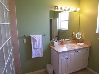 Cape Coral house photo - Master Bathroom. Walk-in shower, vanity mirror and hairdryer.