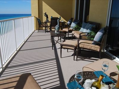 Large 280 sq.ft. covered beachfront balcony with comfortable cushioned furniture