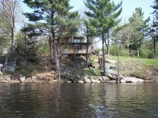 RiverRock, a rustic cabin on a rocky bluff overlooking the Indian River