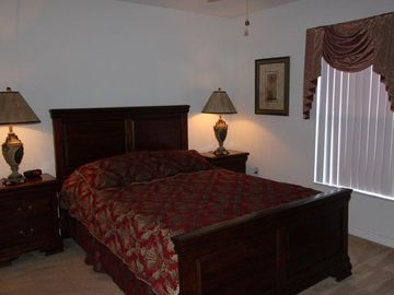 Second Master Bedroom with queen sized bed and connecting bathroom.
