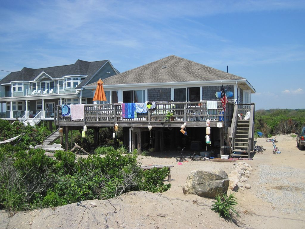 Charming beach cottage rental private beach vrbo for Beach front cottage