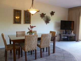 Poipu condo photo - Dining room easily seats 6 with Large Screen TV in Living Room