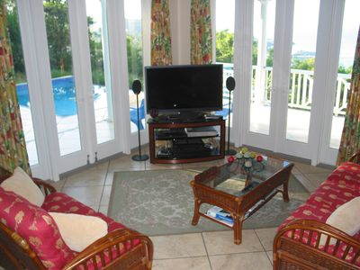 Entertainment center includes HDTV, 8 speakers, Blu-ray player, Wii, iPad Dock