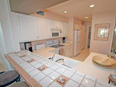 The kitchen has newer appliances &  includes a dedicated washer/dryer area.